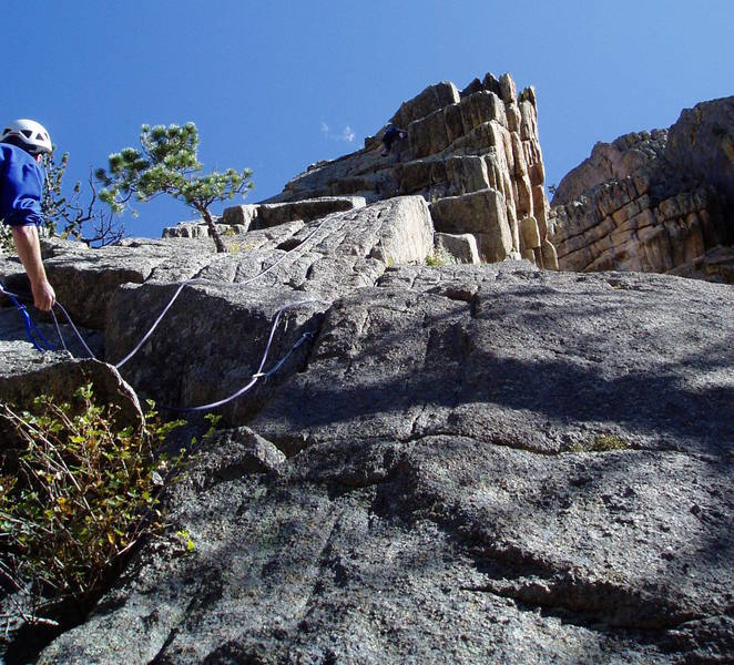 After the last crux. Lenny Miller belaying. Photo by Chuck Graves.