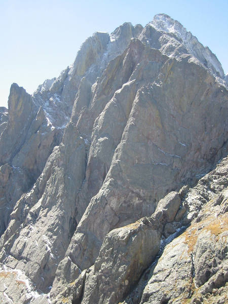 Another view of the north pillar from the NE. The pillar is the steep, sustained ramp with the sun hitting the arete of the ramp.
