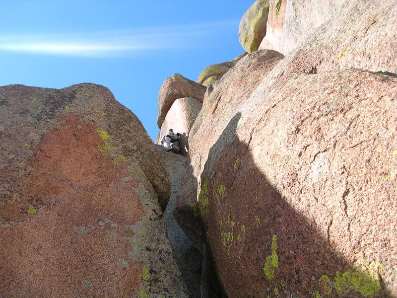 """Me on the upper """"hand crack"""" section of the climb, after exiting the offwidth section.  One more wide section still remains above me.  I did the entire climb as one pitch."""