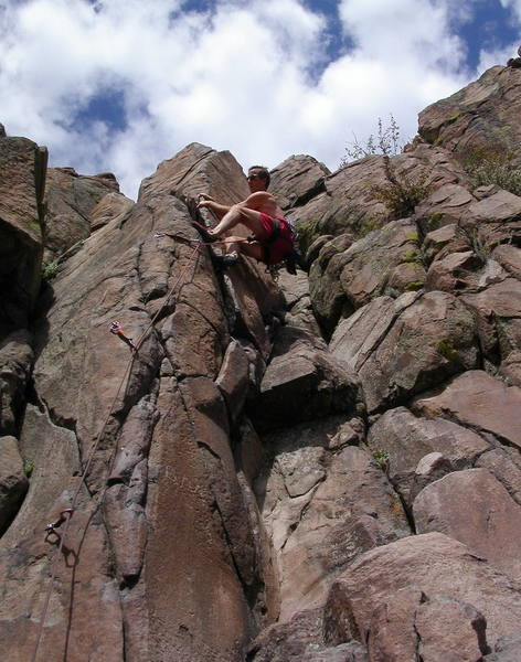 Peter Dillon cranking the layback halfway up BM route.
