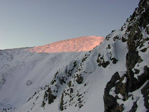 Morning sun rays hitting Grays Peak as viewed from the lower third of Dead Dog Couloir.