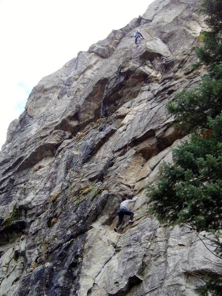 Chuck is nearing the top of P1. I am belaying at the top of P2 after linking P1 and P2. You can rap to the ground from the P2 belay with a 70m rope.<br> <br> Photo by Paul Rezucha.