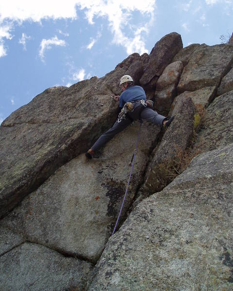 At the P4 crux roof at the very top of the crag. This pitch is contrived but fun. If you're tall enough, it's a stretch for a big hold, and you're done.<br> <br> Photo by Paul Rezucha.