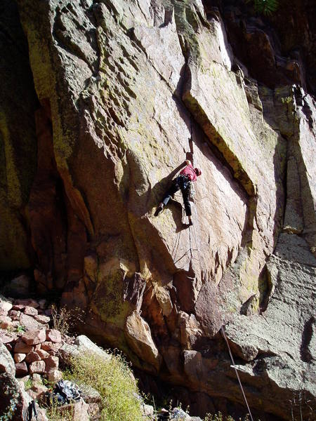 At the crux. The crux involves some strenuous hand jams with poor feet to get your feet up to a big hold in the crack. Captain 4Q 9++s climbs the overhang to the left to the hueco'd face.