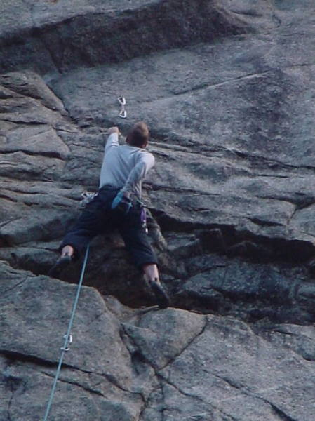Brent Pohlmann just below the crux on the first <br> pitch of Divination.