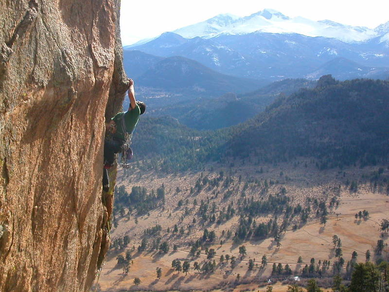 Some steep crack climbing on Lumpy Ridge? Yep, the 2nd pitch of Off The Grid requires good old-fashoined jamming from fingers to fists on overhanging rock. Here's Justin hikin' it on 11/16/04.