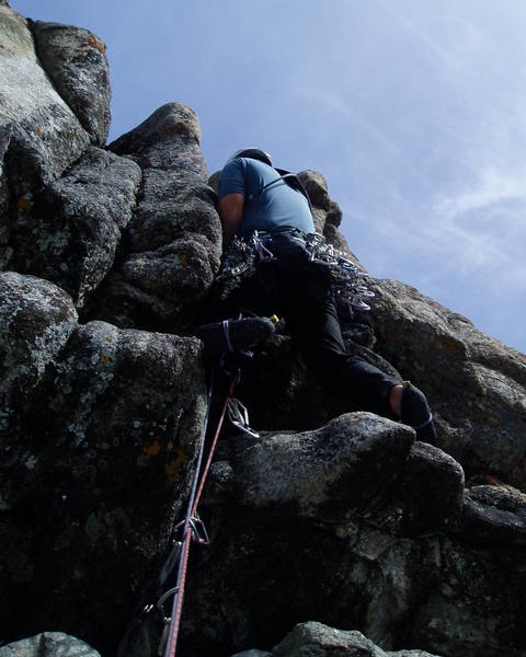 """After the hardest moves on the Black Groove, but not having fun yet. It's hard to get out from here onto the right """"arete"""". Very rounded and overhanging to get to this point."""