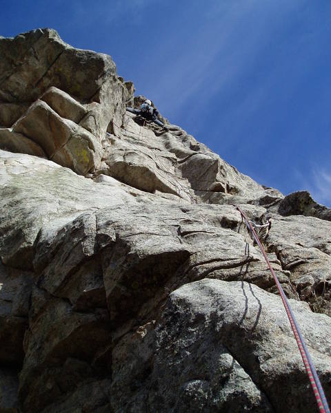 At the top of the P2 crux. I ended up at the top of the rounded left-facing corner and had to stem back left. The lower of the two P2 belay stances is just to my left.<br> <br> Photo by Chuck Graves.