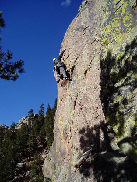 Starting the crux sequence past the 2nd bolt.<br> <br> Photo by Ken Heiser.
