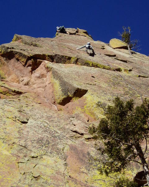 At the upper crux at the 5th bolt. After that it's about hard 5.9. The climber at the top is on Moonlight Drive and is trying to finish directly up the arete.