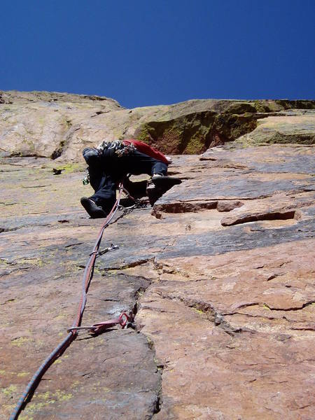 Chuck climbing the crux to the left of the corner. This is maybe 2 letter grades easier than climbing the face just right of the corner, but you have to get here first, and that's hard.