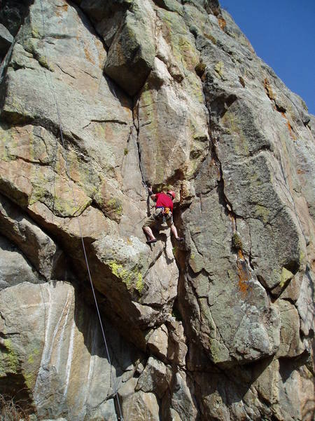 Entering the upper corner after some steep, funky rock. Maximum Security (9+ or so) traverses right from where Luke is and up the thin crack.