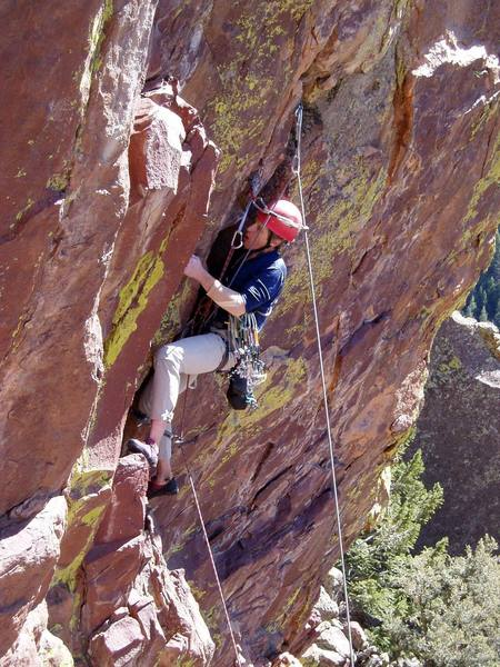 Wedging your shoulder into the wide crack enables you to place gear high and let go with both hands.