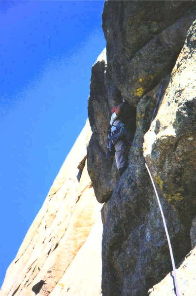 Getting ready to do the crux moves on the <br> route.
