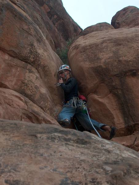 Eli starting the offwidth crux of pitch 2.