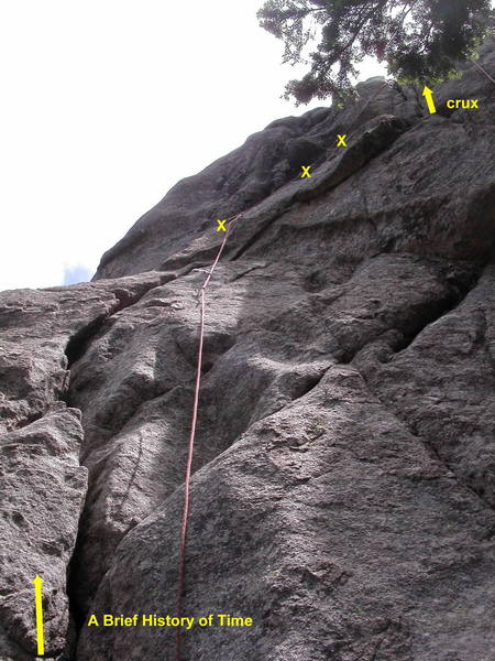 A Brief History of Time.  Climb the big flake, place a couple of pieces of pro, and step left onto a slab.  Work up and right past three bolts, then fire the flared finger and hand crack (crux). More slab climbing leads to the anchor.