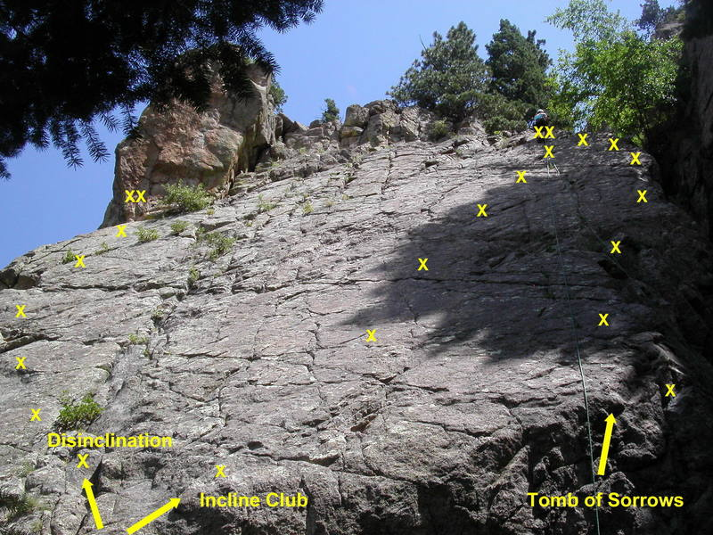 Routes on the Avalon slab.  Tomb of Sorrows starts on the arete or in the chimney to the right.  Incline Club and Disinclination start in a right-facing corner below the slab.