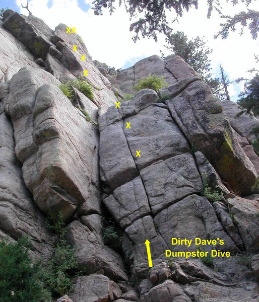 Dirty Dave's Dumpster Dive.  The lower section can be climbed using the corner left of the bolts, the hand crack right of the bolts, or just the face and thin crack by the bolts.<br> <br> The upper wall has a 10a face move past the next-to-last bolt.