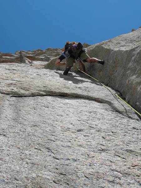 Justin doing battle with the 4th pitch. Another beautiful dihedral with sturdy 5.11 climbing and hard fought gear.