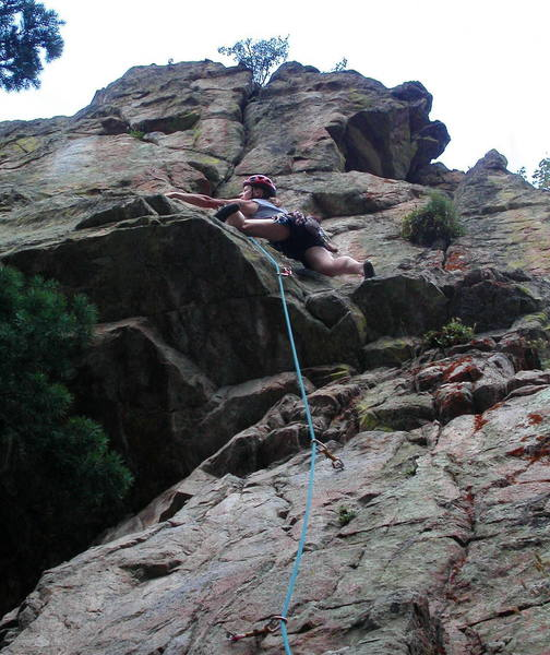 Christa Cline stepping left to the steep headwall on Tower of Power.