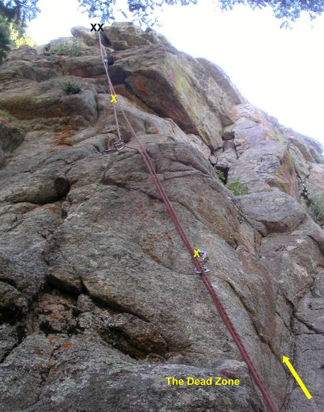 The Dead Zone.  Start in the same corner as Dead Can Dance.  Stem up and clip a bolt, move left, and climb thin cracks to a bulge.  Clip a second bolt, surmount the bulge (crux), and continue up steep cracks to the top.