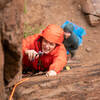 Zach venturing through the harsh weather on his third trad lead.