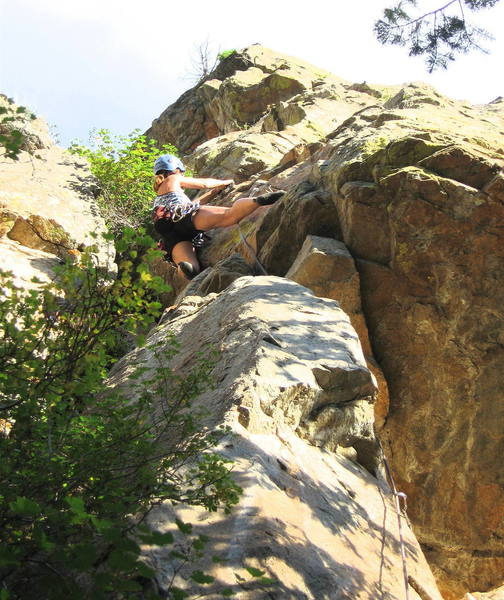 Marga Powell stepping right at the crux.