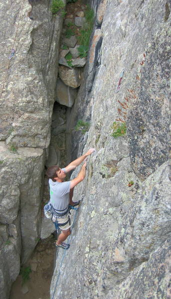 Climber on the sustained crux section of Dead Again.