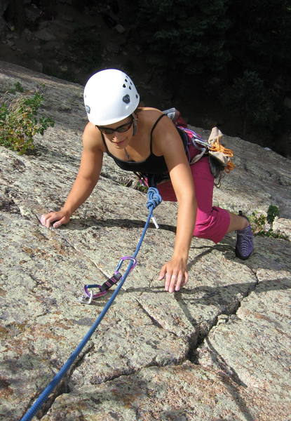 Deanna DeMarco making the final thin moves to the top of Disinclination.
