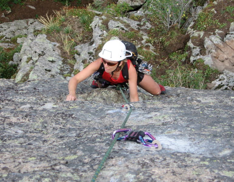 Nickie Kelly at the horizontal crack on the steep upper face.  The hardest moves are above her at the last two bolts.