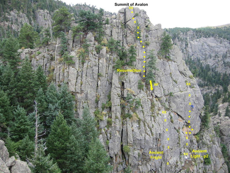 Routes on Crack Land, part of Avalon.  Approach via the first pitch of Ancient Light, or by a 4th-class scramble from the left.<br> <br> Note: the rappel tree below Resurrection shown in the photo no longer exists.  A new 2-bolt anchor has been installed slightly above this point.