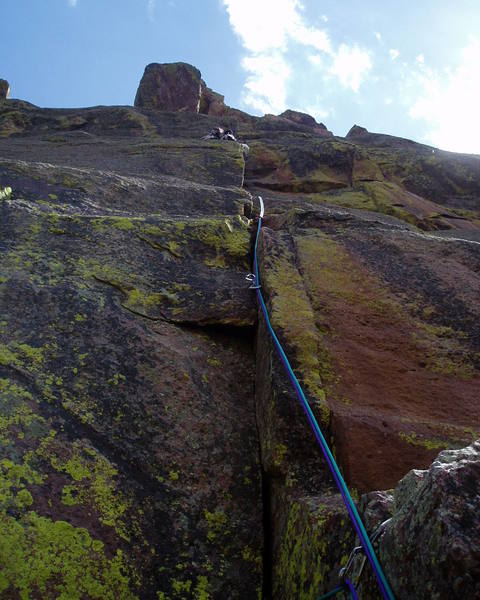 Not exactly an action shot, but this shows the route from the belay. Notice Lenny's twin 7.x dental floss ropes.<br> <br> Photo by Lenny Miller.