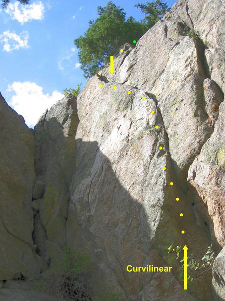 Curvilinear.  Stem the corner and climb the crack and ramp to the top.  Short but sweet.