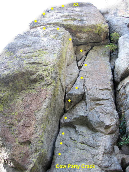 Cow Patty Crack.  Climb the corner, traverse left at the horizontal crack, and continue to the chain anchor.<br> <br> Short but fun.