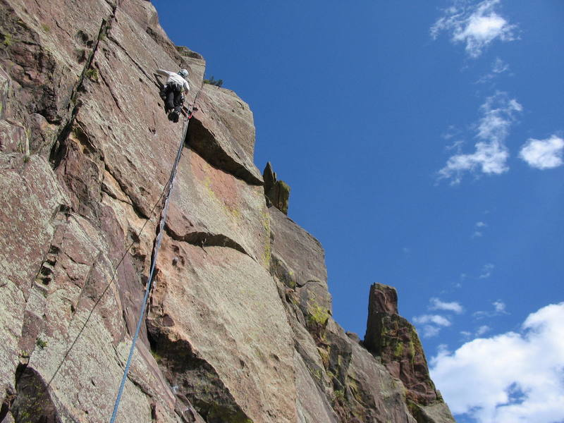 Setting up for the reach back into the crack.  Photo by Steve Bond
