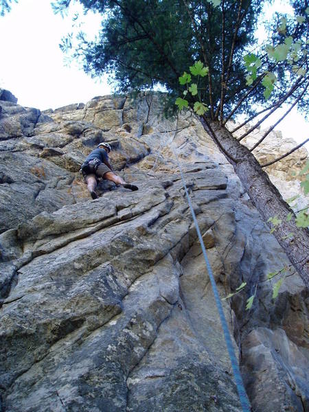 There's a moderate slab move here and a finger jam move higher to get to the ledge. You may be ablee to see the long slings on the anchor--the bolts are far apart. The anchor really needs to be fixed. Perhaps it was set up this way to minimize the swings when toproping Merry Men, on thte left, and Robbin' the Hood, on the right.
