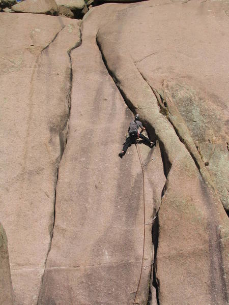 Just above the crux 8+ moves at the bolt.  Stemming through this section eases the dificulties.