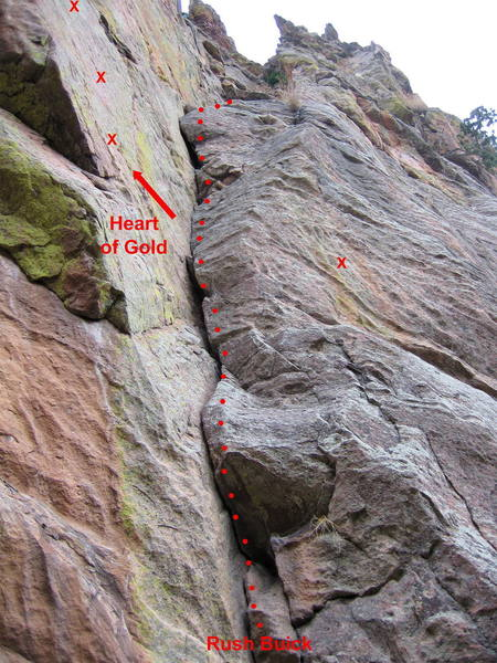 Rush Buick climbs the right-facing corner; Heart of Gold breaks left and climbs a steep bolted face.  The bolt on the right is on Emergency Brake.<br> <br> There is NO rap anchor atop Rush Buick; bring slings and rings and try to find a place for a rap anchor after 70', or be prepared to climb to the top of the ridge and exit to the left.
