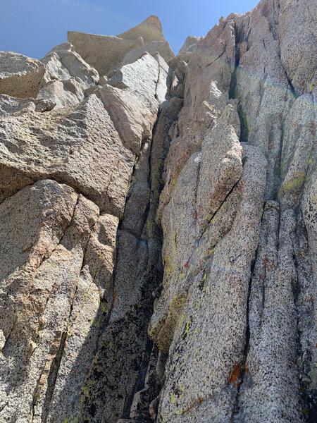 Rock on the upper ridge, solid.