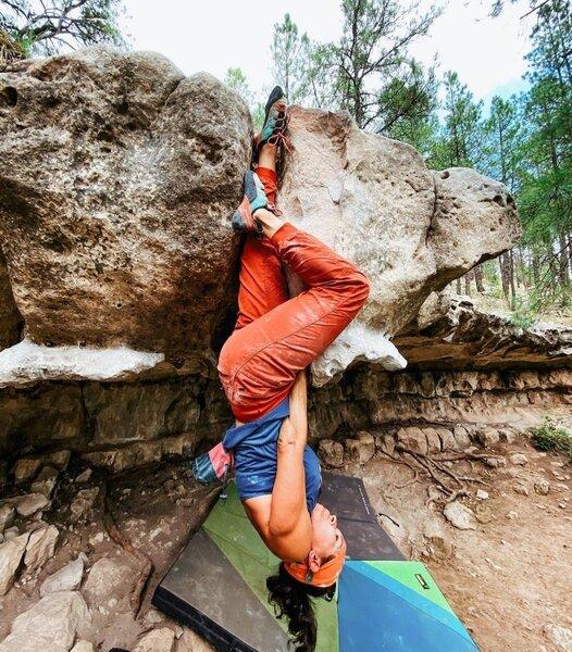 Climber Idaliza Sosa with an invert top out. Photo by Ashton Searing