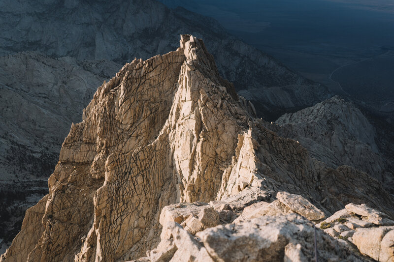 Looking back down at the main tower as I belay my partner up the ridge
