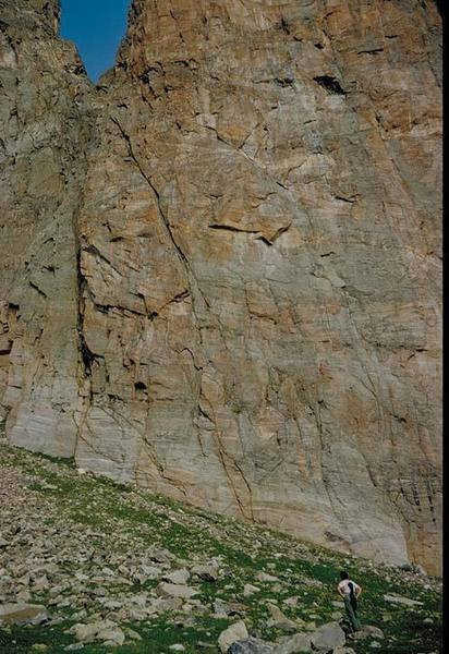 Lower east face of Ptarmigan Tower 2.  Tundra Turkey Crack (5.8) is the clean left-slanting wide crack near the center.