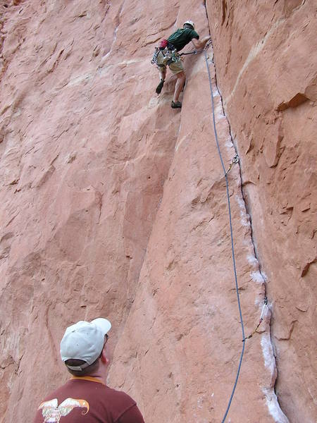 Jon keenly watches Ely as he climbs Anaconda.