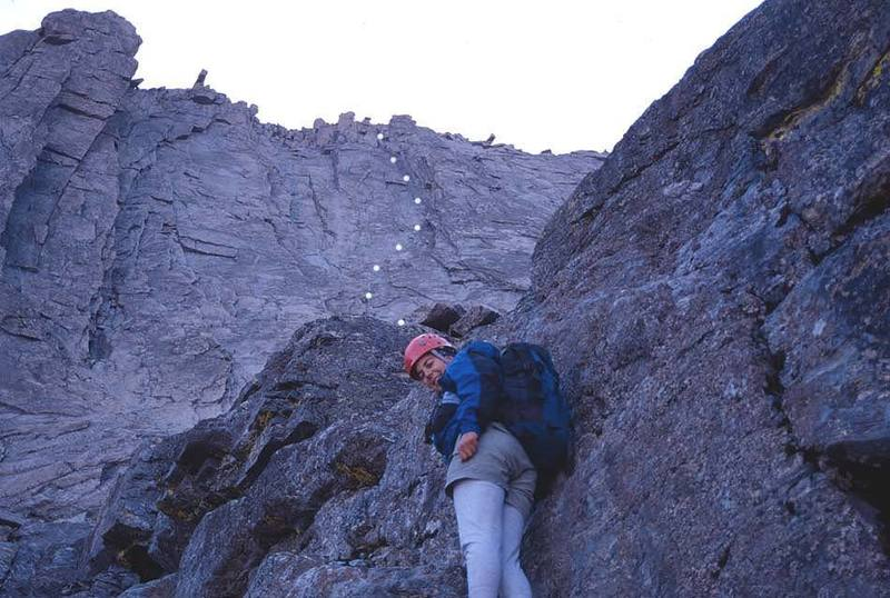 Koren scrambling up to the base of the West Face with the route marked above.