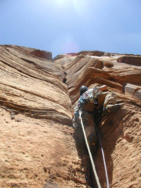 Heading for the bolt in the offwidth on Pitch 2 (5.9).