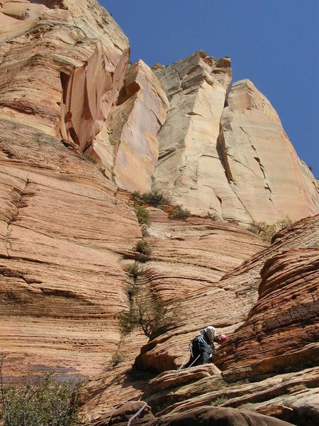 Encountering some 5.7 ground on the slabs (Pitch 8). Isaac's headwall looms above.