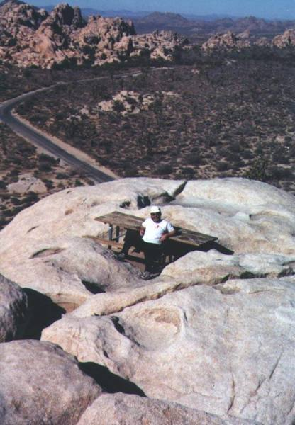 A climbing buddy ready for a picnic atop Intersection Rock (prolly winter '00).