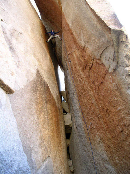 Holden flies up the variable chimney and stemming moves of this wild climb. Copyright 2003, by Randy V.