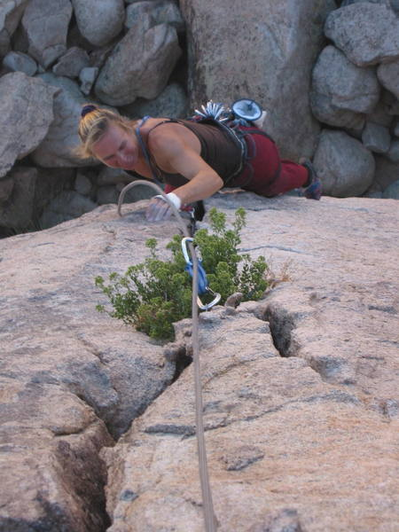 Ivana above the roof on the upper easy crack.