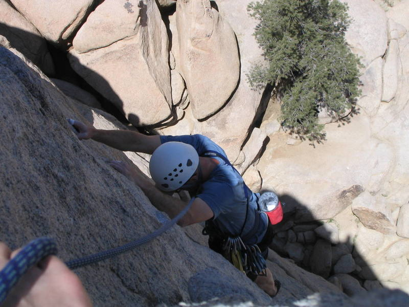 Michael Bains on the final moves before topping out.  April 20, 2004